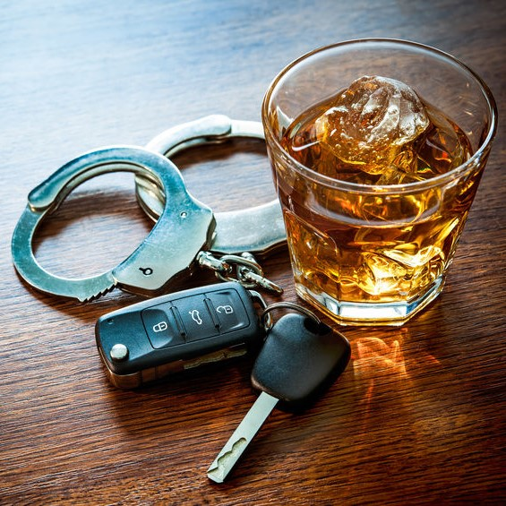 DUI imagery of a glass of whiskey, cuffs and car keys